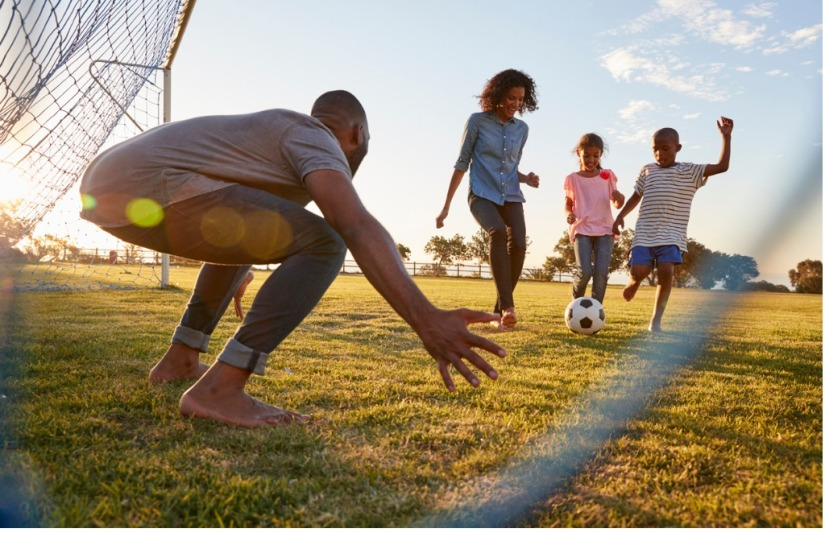 boy-kicks-a-football-during-a-game-with-his-family-picture-id829627936 (1)